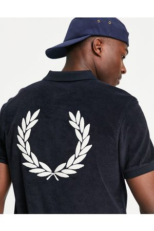 Fred Perry – Polohemd aus Frottee in Marineblau