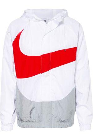 Nike Passform laut Hersteller: Loose Fit. Gerader Schnitt. Wasserabweisend. Kapuze mit Tunnelzug. Raglanärmel. Windschutzblende mit Druckknöpfen. Schließt mit Reißverschluss. Seitliche Eingrifftaschen. Elastische Bündchen an Ärmeln und Saum. Mit Mesh-Futt