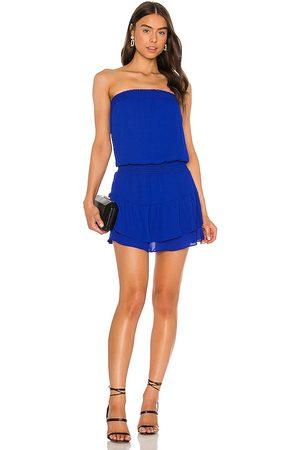 krisa Smocked Strapless Mini Dress in . Size M, S, XS.