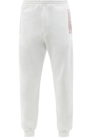 Alexander McQueen Logo-tape Loopback Cotton-jersey Track Pants