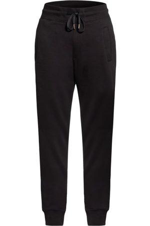 Versace Jeans Couture Schmal zulaufendes Bein. Elastischer Taillenbund mit Tunnelzug. Seitliche Eingrifftaschen. Leistentasche am Gesäß. Bündchen an den Beinenden. Soft Finish innen. Logo-Applikation an der Gesäßtasche. Reine Baumwolle. Maße bei Größe M:-