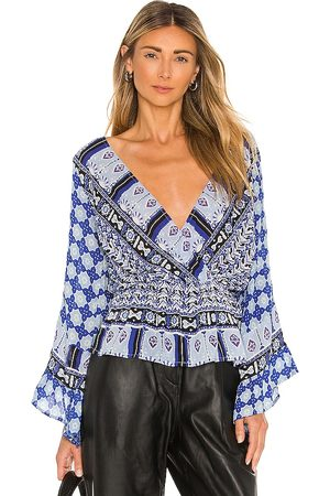 Free People Rosalie Wrap Top in . Size M, S, XS.