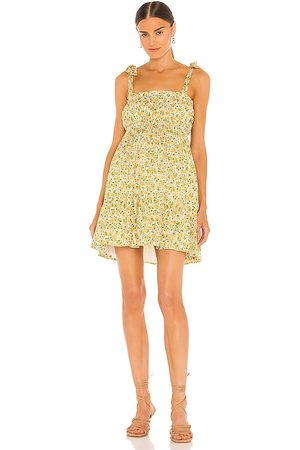 FAITHFULL THE BRAND Elwood Mini Dress in . Size XS, S, M, XL.