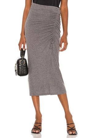 Song of Style Rayna Midi Skirt in . Size XXS, XS, S, M, XL.