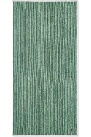 Ralph Lauren Die kuscheligen Jacquard-Handtücher von aus 100% luxuriöser Baumwolle präsentieren sich in klassischen Farbkombinationen. Sie überzeugen mit ihrem sportlichen Look, den hochwertigen Eigenschaften, lassen sich in der Waschmaschine reinigen und