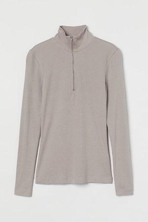 H&M Geripptes Rollkragenshirt mit Zipper