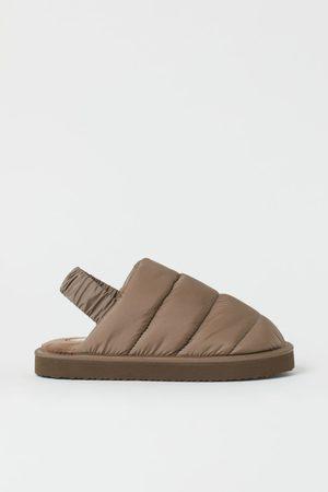 H&M Gesteppte Pantoffeln
