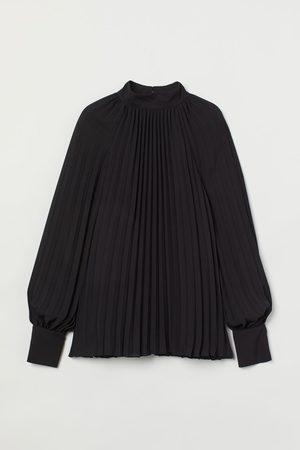 H&M Plissierte Bluse