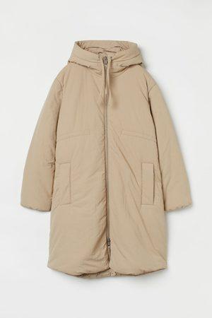 H&M MAMA Wattierte Jacke mit Kapuze